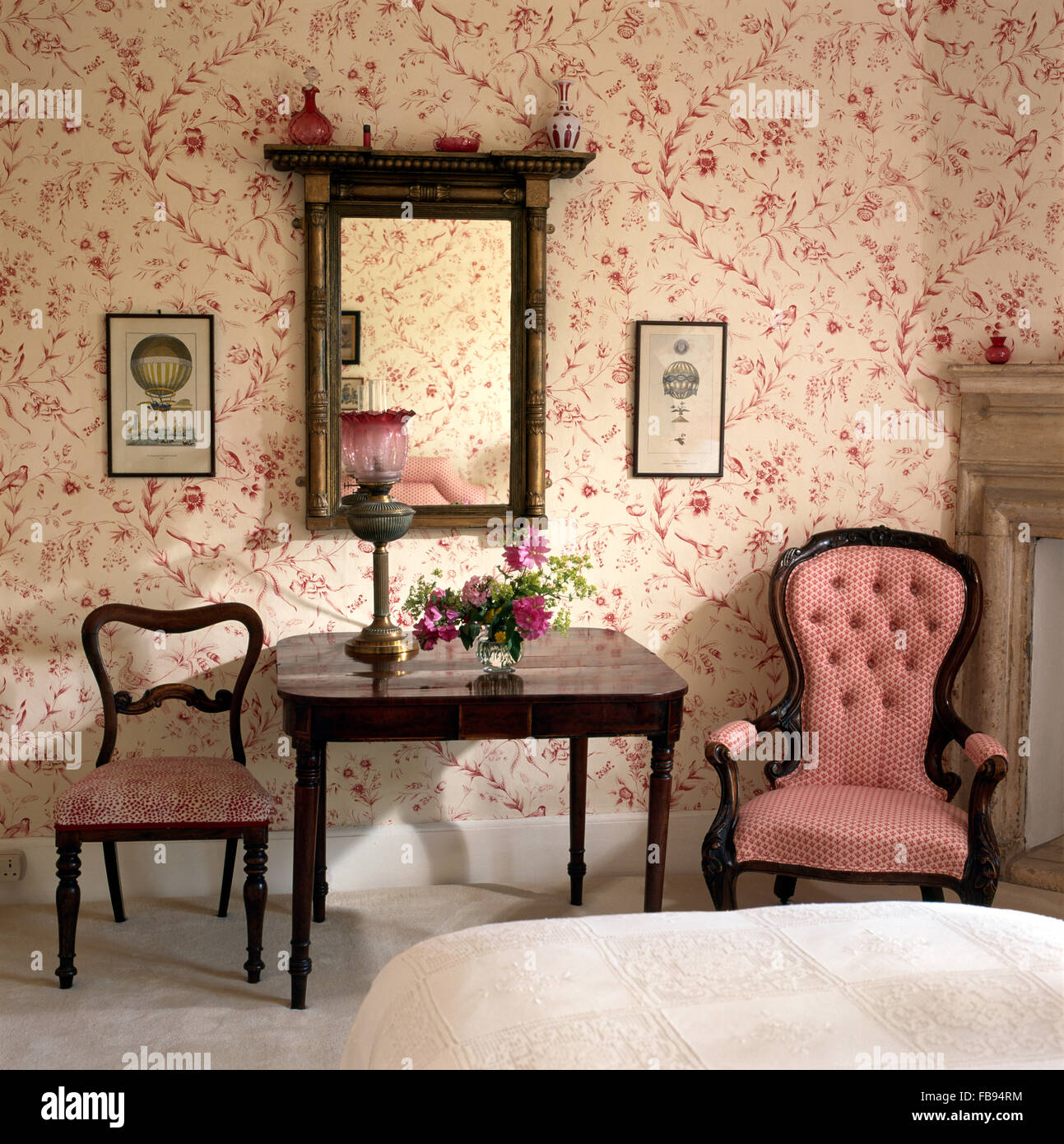Pink button back Victorian chair beside console table in bedroom ...