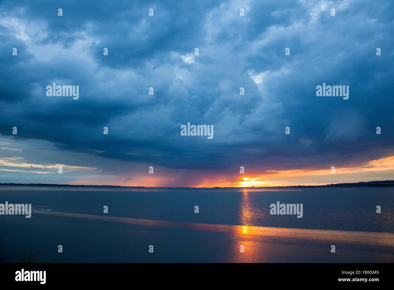 Storm at sunset, Humber estuary, dark skies at sunset, clouds and rain - Stock Image