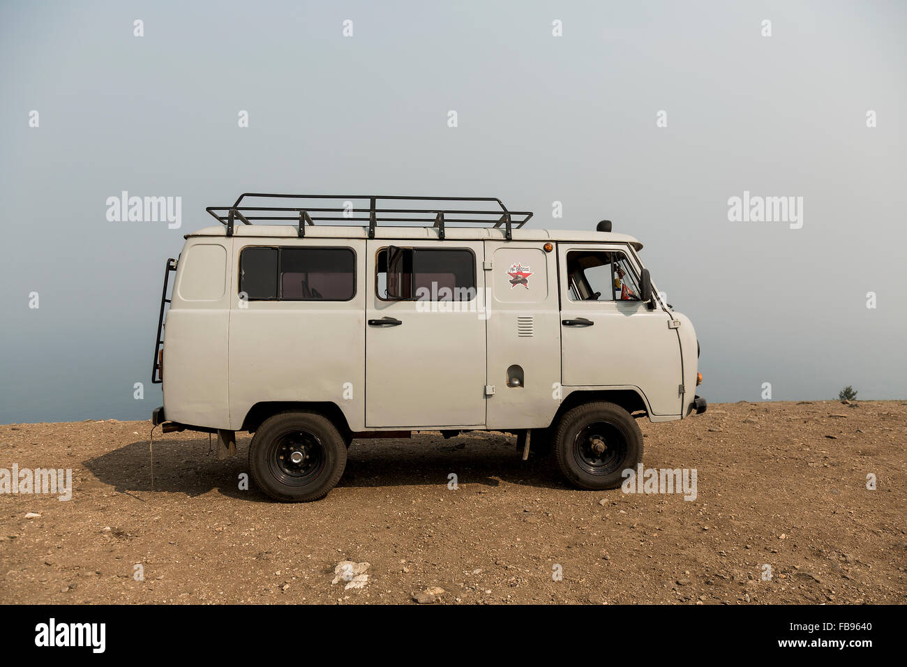 Olkhon Island - Lake Baikal, Russia. July 2015- Russian Uaz van parked on a cliff in Olkhon Island. - Stock Image