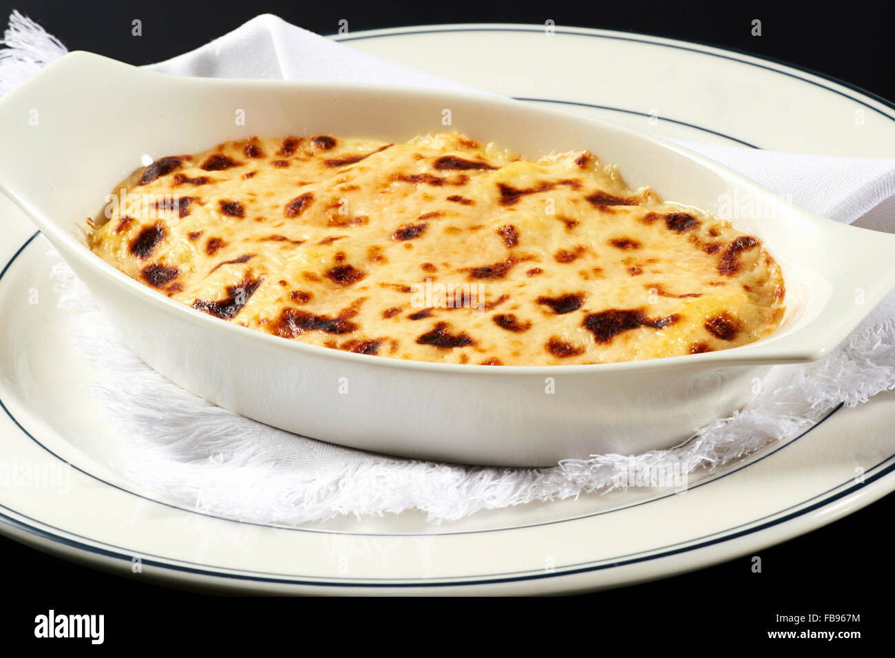 Bowl of traditional Italian lasagna - Stock Image