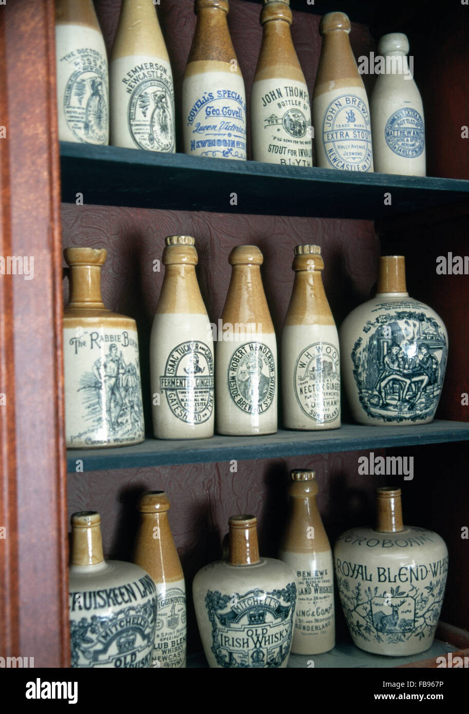 Close-up- of a collection of antique stoneware ginger beer and ale bottles - Stock Image