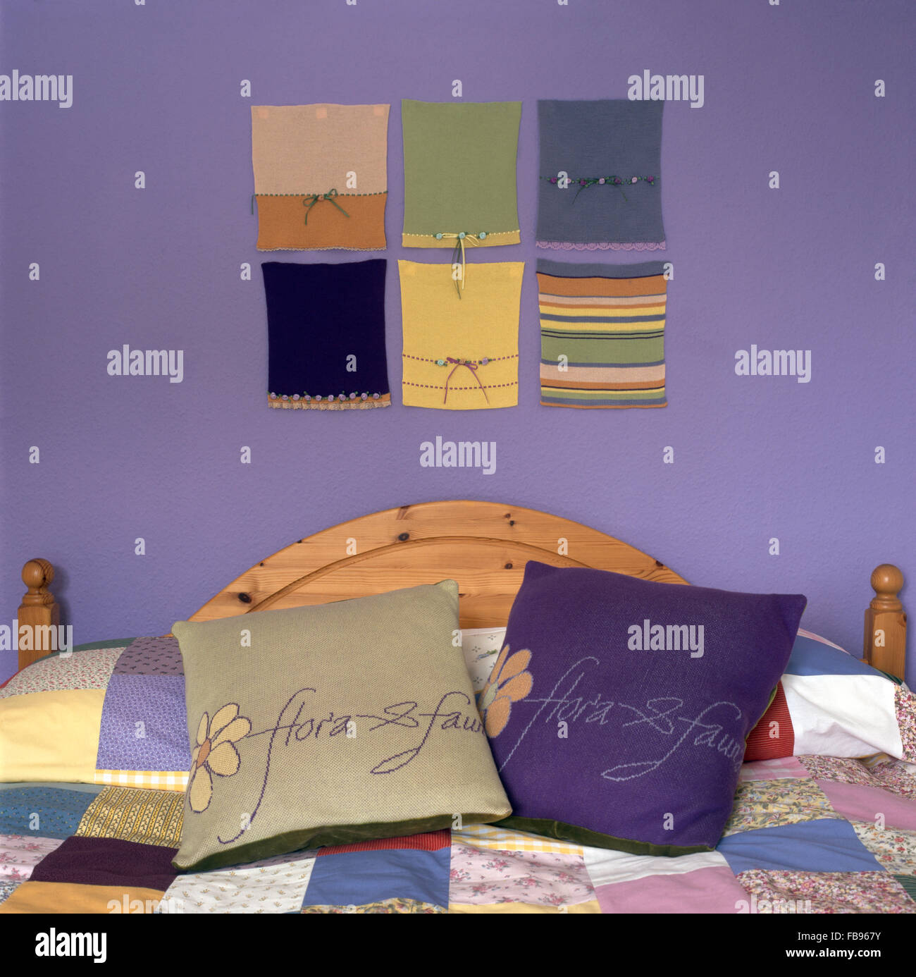 Nineties Bedroom With Simple Fabric Wall Hanging Above Pine Bed With  Embroidered Cushions And Patchwork Quilt