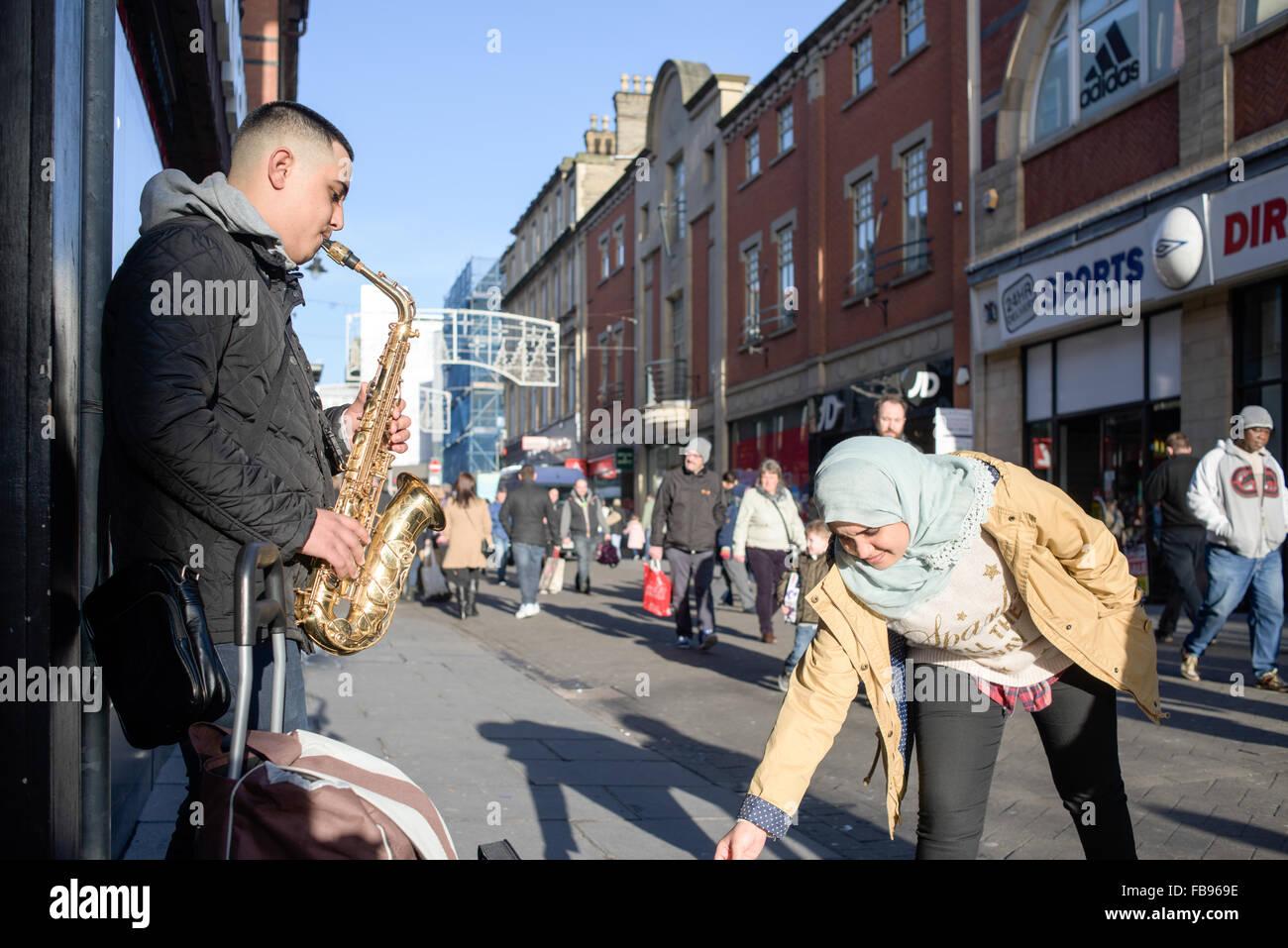 Eastern European Street Musician ,Busking on the city centre street's of Nottingham,UK. - Stock Image