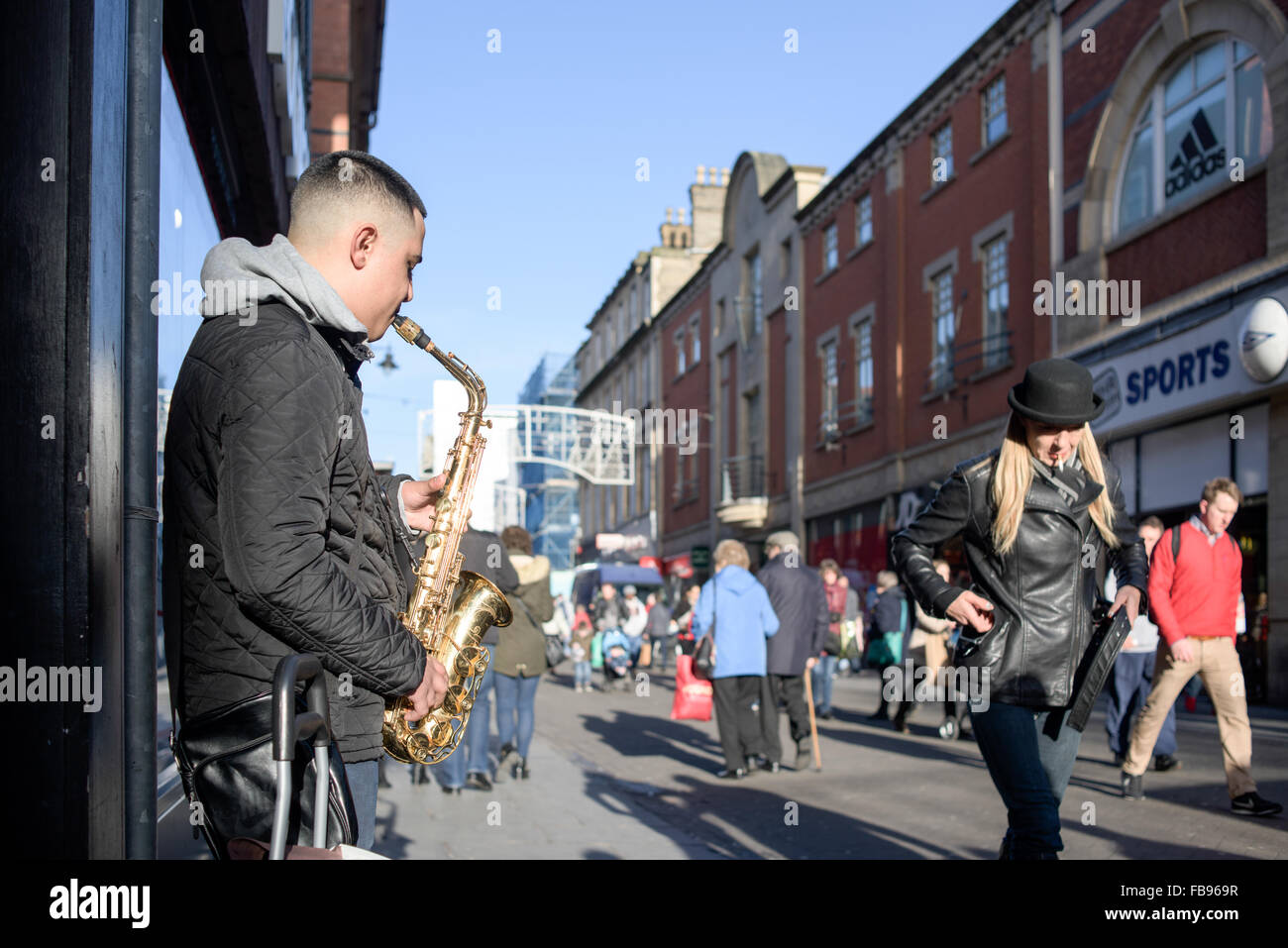 Eastern European Street Musician ,Busking on the city centre streets of Nottingham,UK. - Stock Image