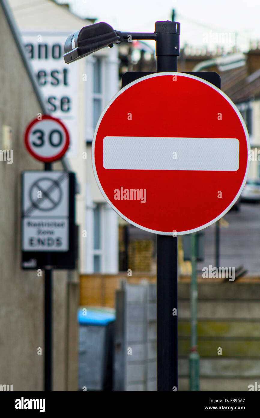 No Entry sign with speed limit in backgroung - Stock Image