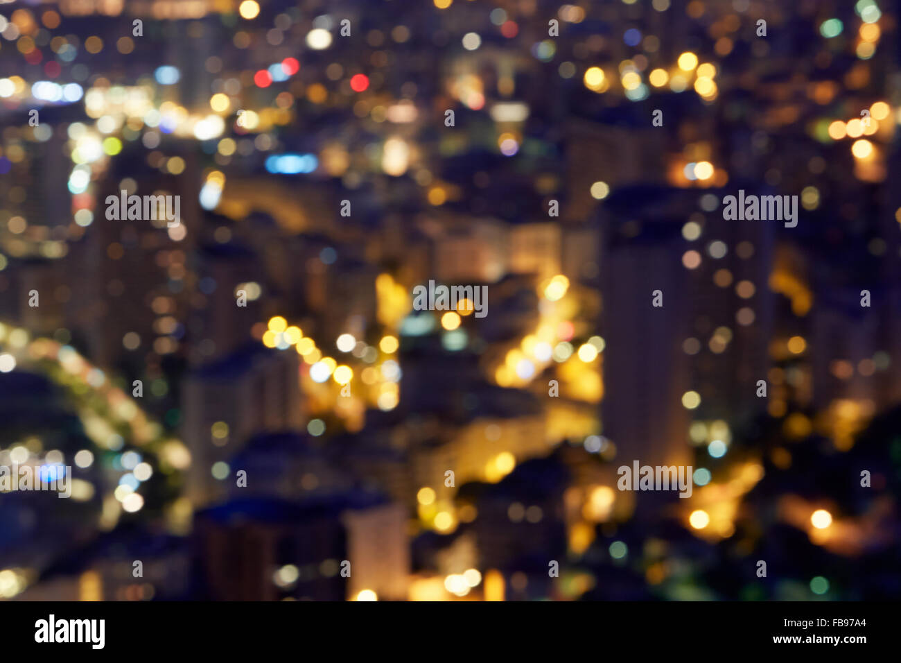 City buildings background at night, unfocused - Stock Image