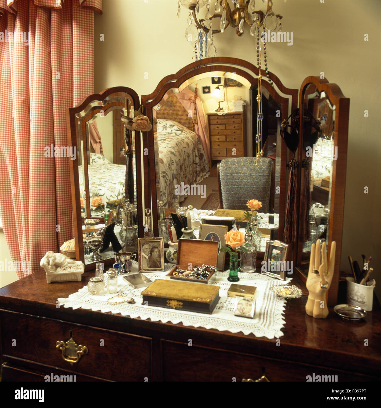 Close-up of a vintage dressing table with triple mirror - Close-up Of A Vintage Dressing Table With Triple Mirror Stock Photo