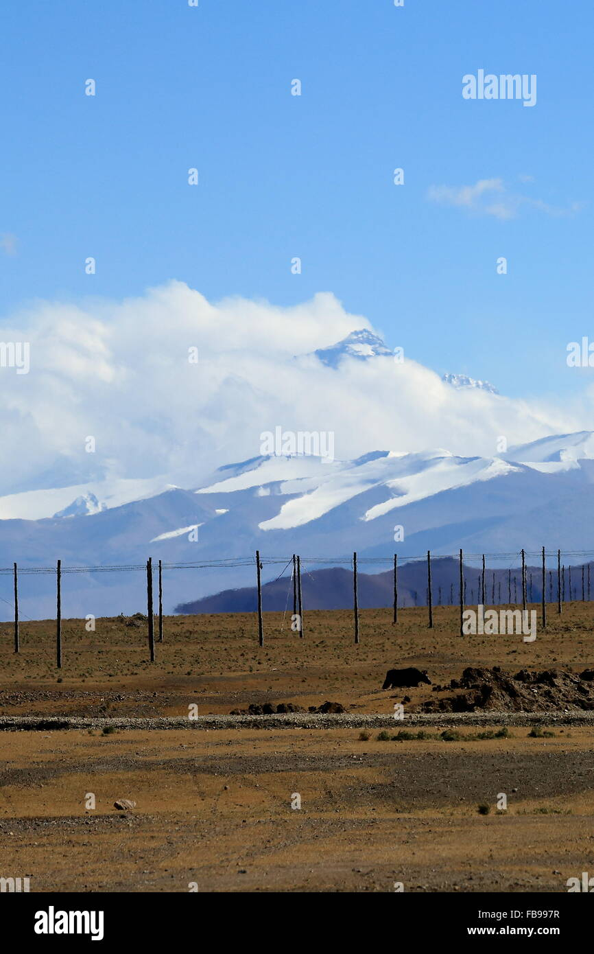 Mahalangur section-high Himalayas. Point of Mt.Chomolungma-Sagarmatha-Holy Mother-Everest protruding among clouds - Stock Image
