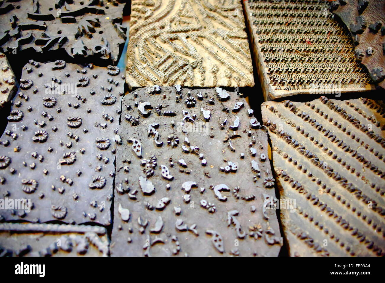 Traditional nepalese types for woodblock printing in the windowshop of a souvenir shop in the Thamel area of Kathmandu - Stock Image