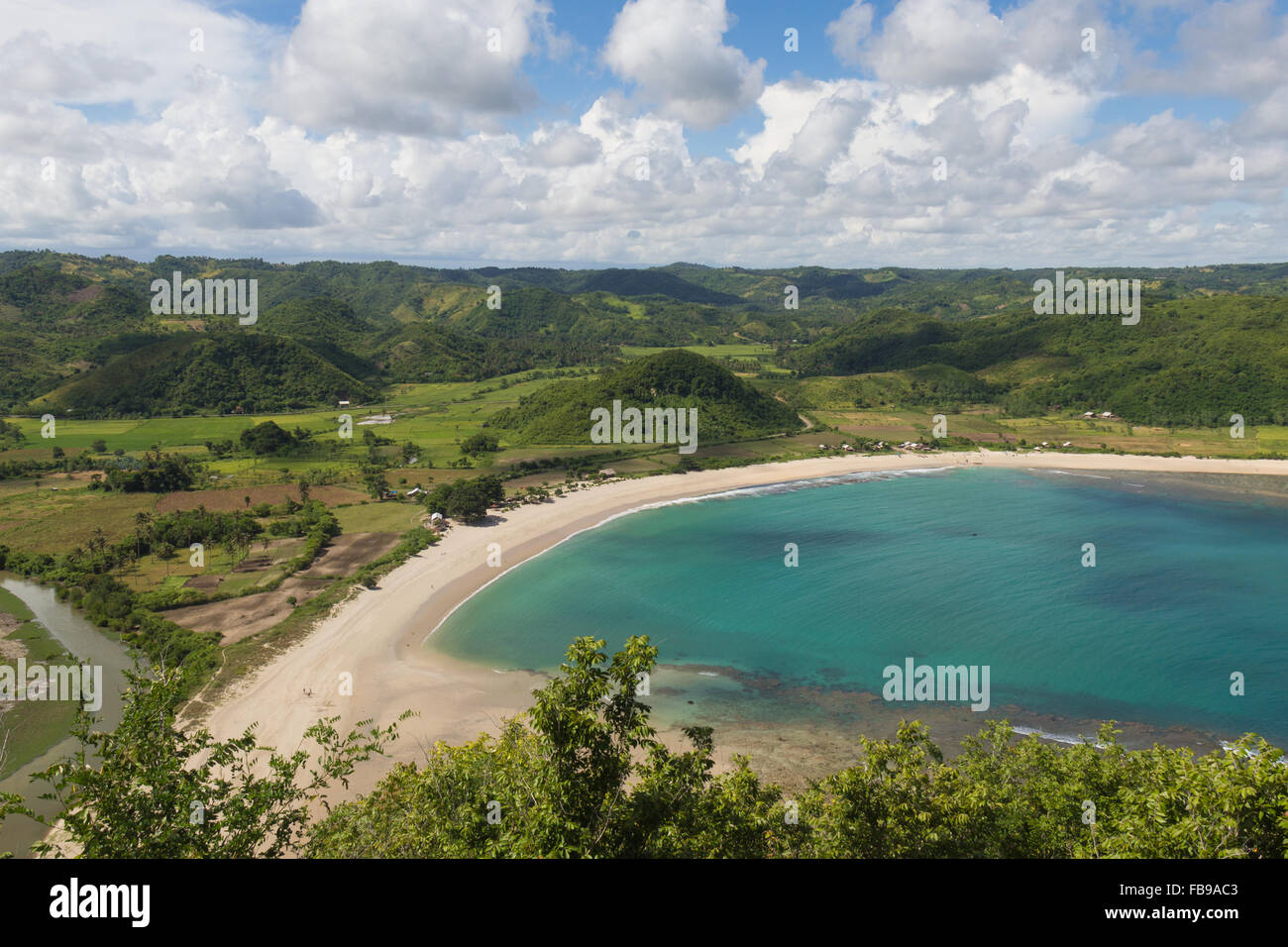 View to the beach of Air Guling and the surrounding hills I Lombok I Indonesia Stock Photo