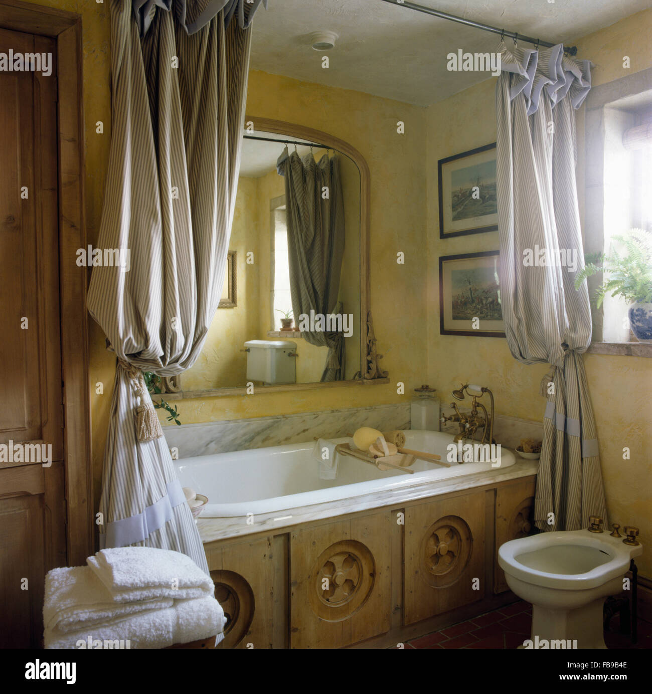 Striped Shower Curtains On Bath With Reclaimed Carved Wood Panel In  Eighties Bathroom With A Bidet