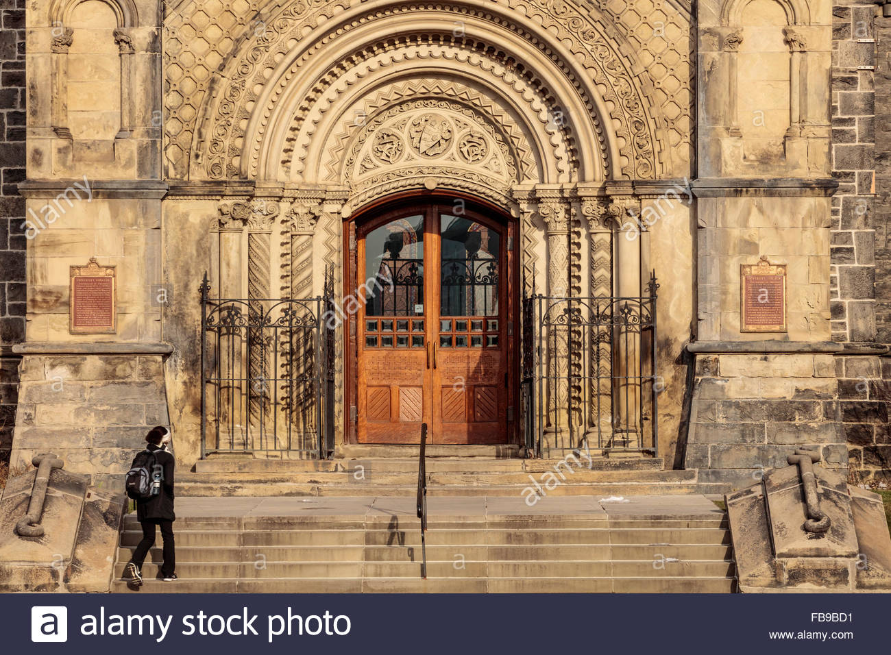 Front doors of University College in romanesque style at the University of Toronto in Toronto Ontario Canada - Stock Image