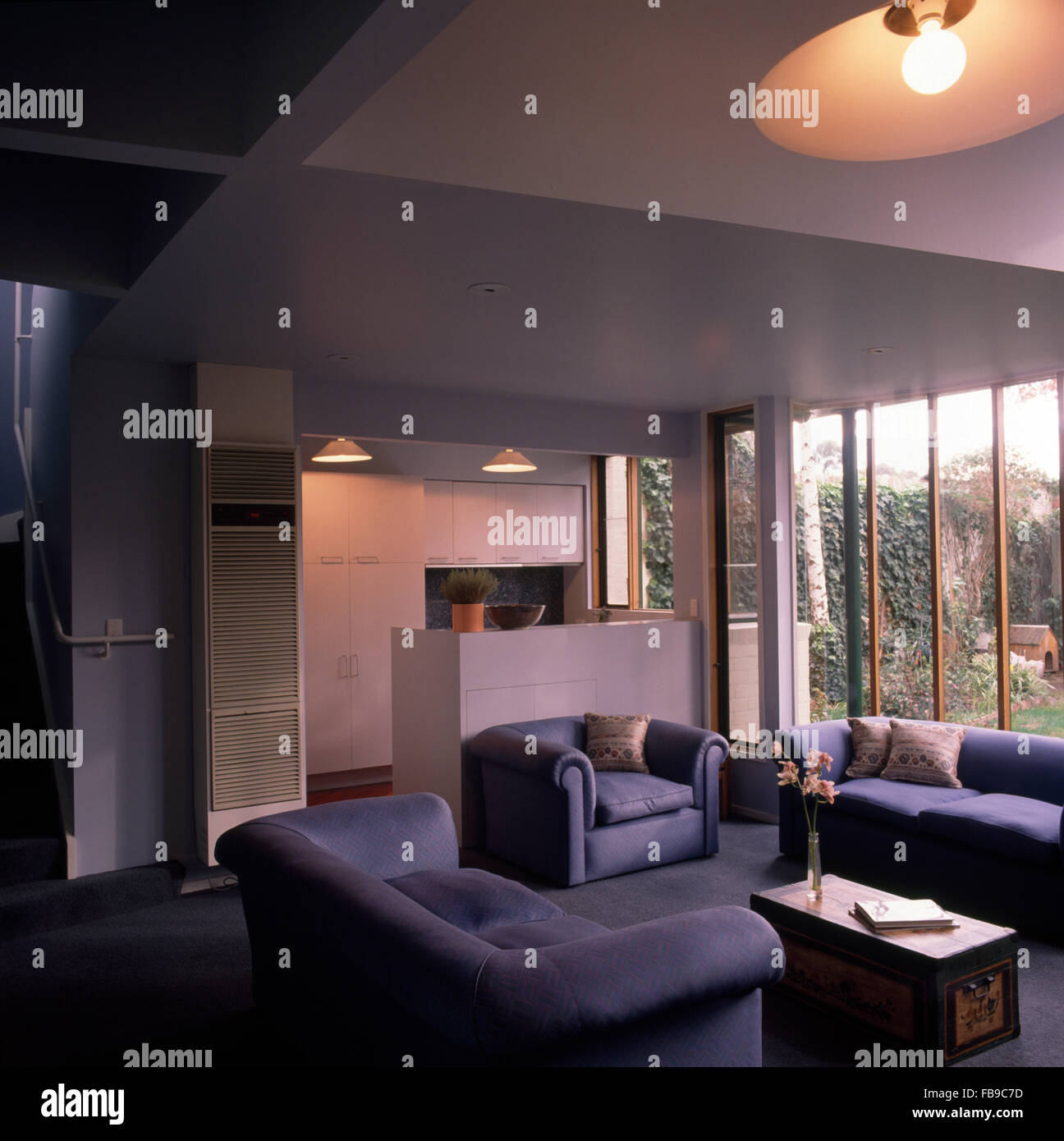 Pale Blue Sofas And Armchair In An Open Plan Nineties Living