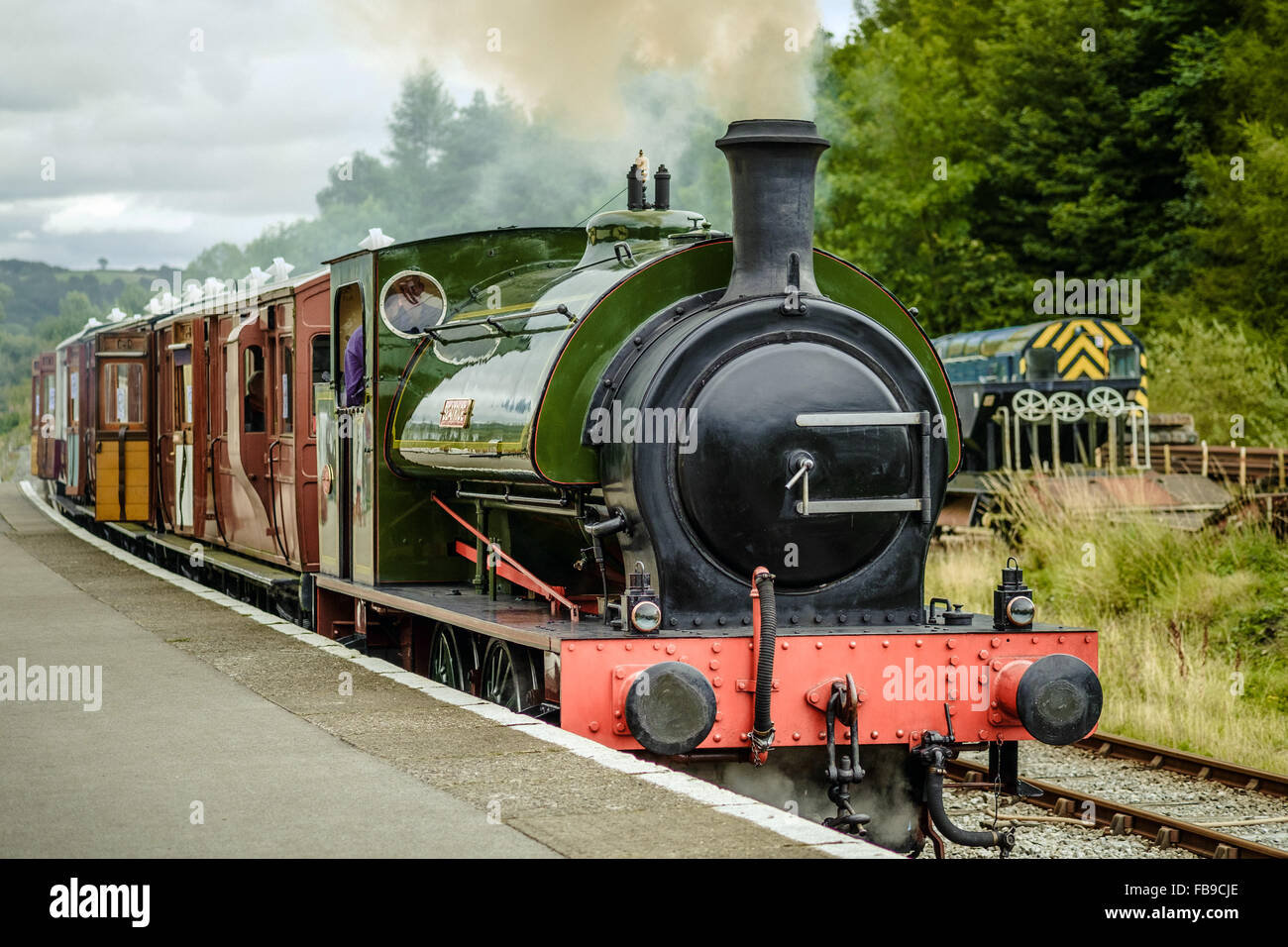 Steam train pulling out of Bolton Abbey Station, near Bolton Bridge, North Yorkshire. - Stock Image