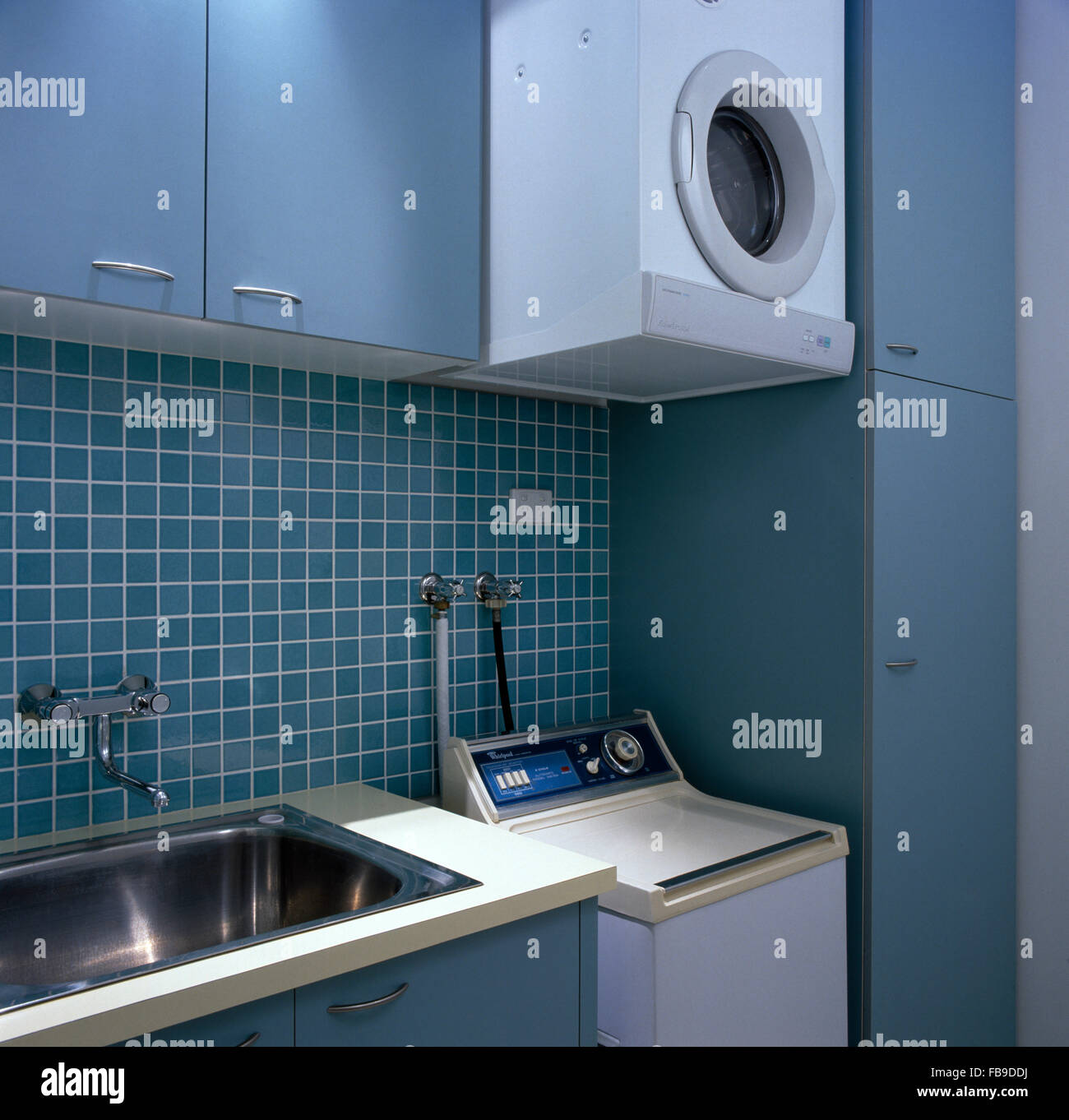 Wall Mounted Tumble Dryer Above Washing Machine In