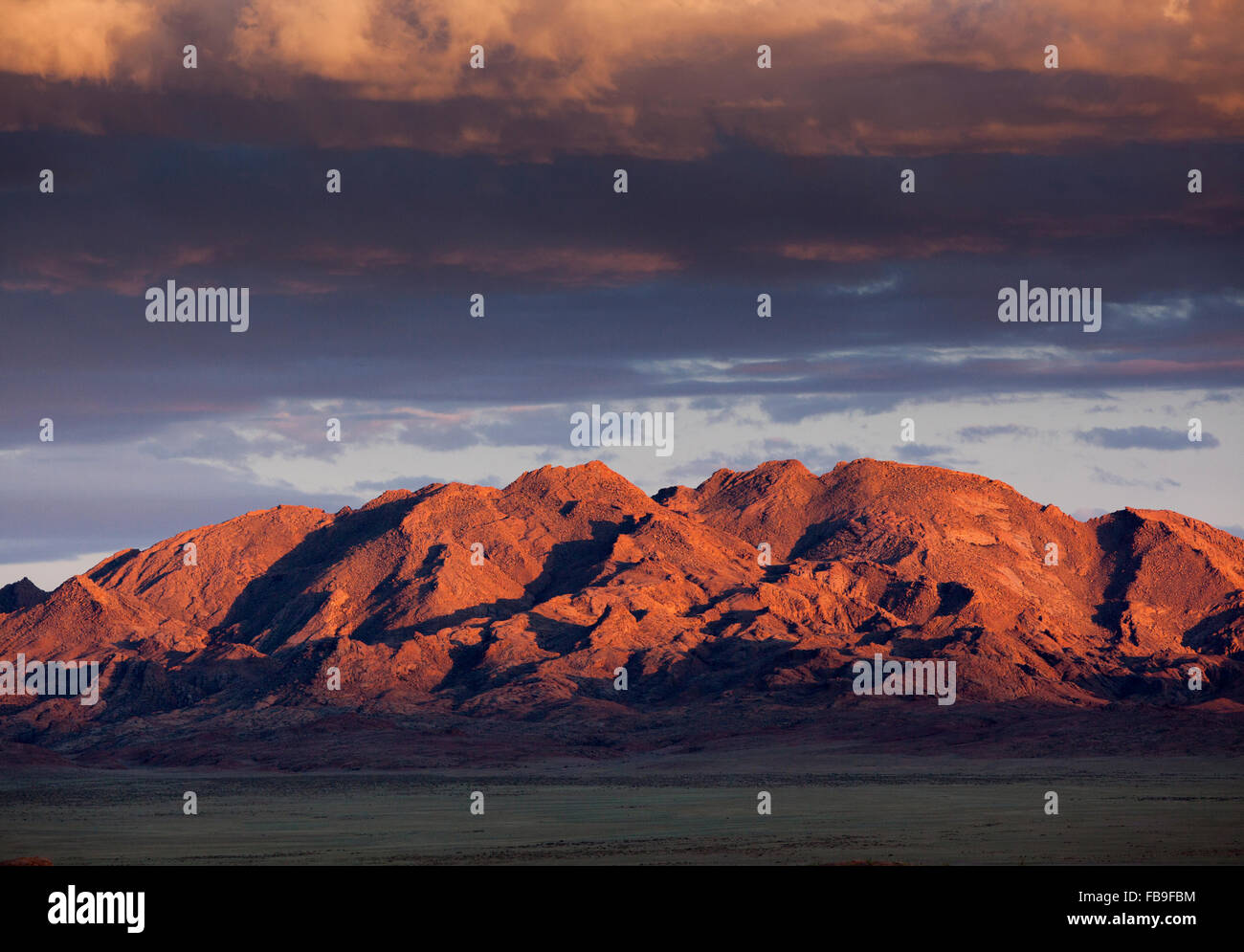 Sunset on the mountains near Khovd and Achit Lake in remote far-western Mongolia. - Stock Image