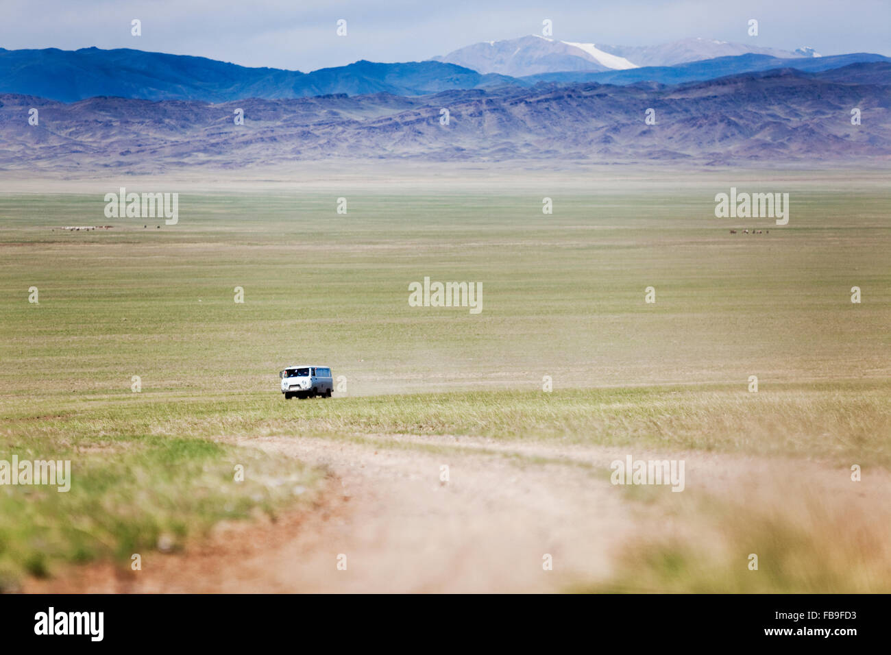 A Russian 'bread loaf' van on the road in far-western Mongolia. - Stock Image