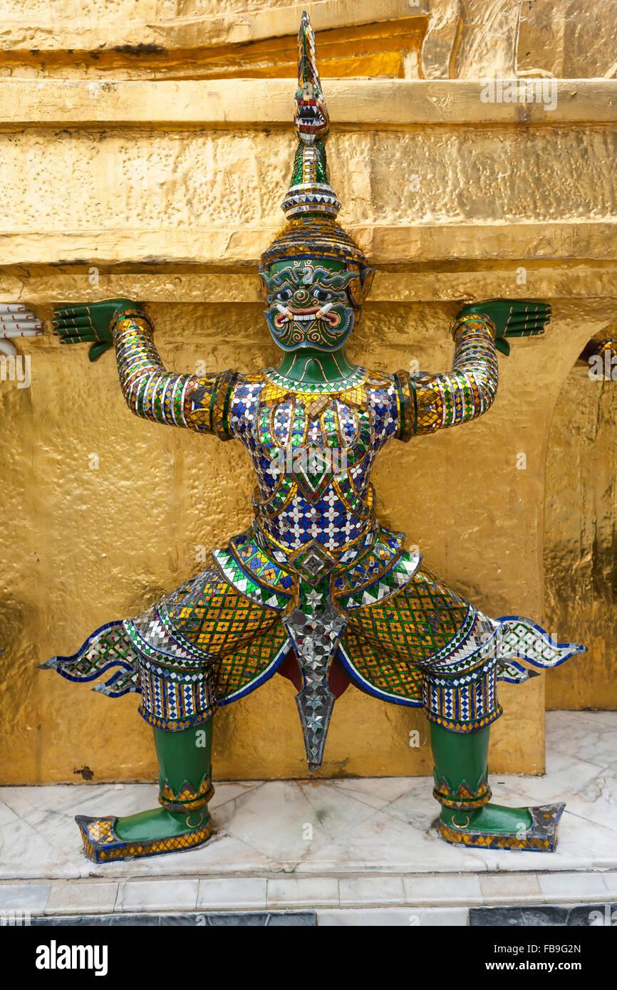 Caryatid at Gold Chedi in Wat Phra Kaeo Temple, Royal Palace, Bangkok, Thailand - Stock Image