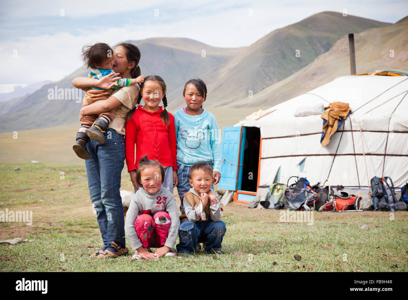 Kids posing for a portrait outside their family ger in Kharkhiraa Turgen National Park, Mongolia. - Stock Image