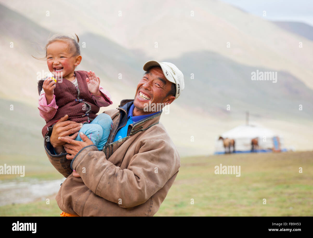 Father and daughter share a laugh Kharkhiraa Turgen National Park, Mongolia. - Stock Image