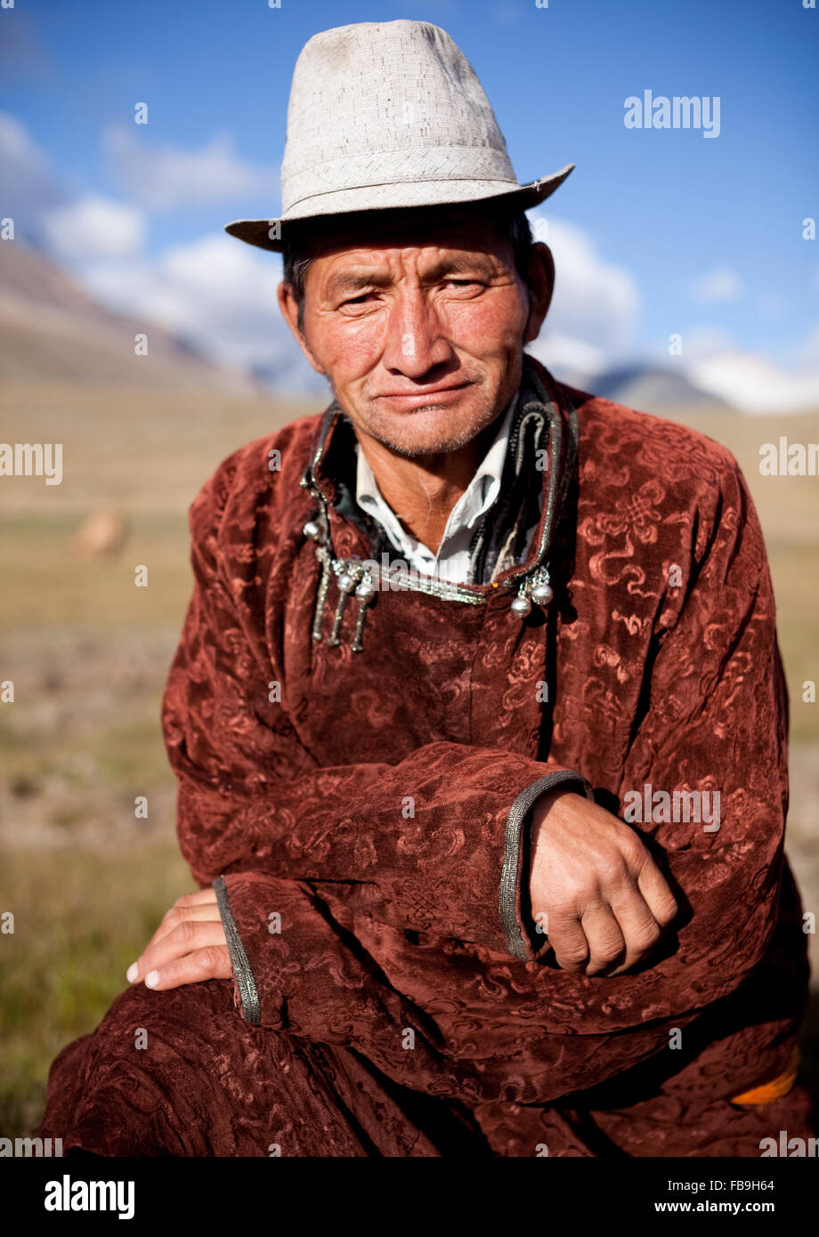 Dashnyam the herder and guide poses for a portrait in the Kharkhiraa and Turgen National Park in the Altai mountains, - Stock Image