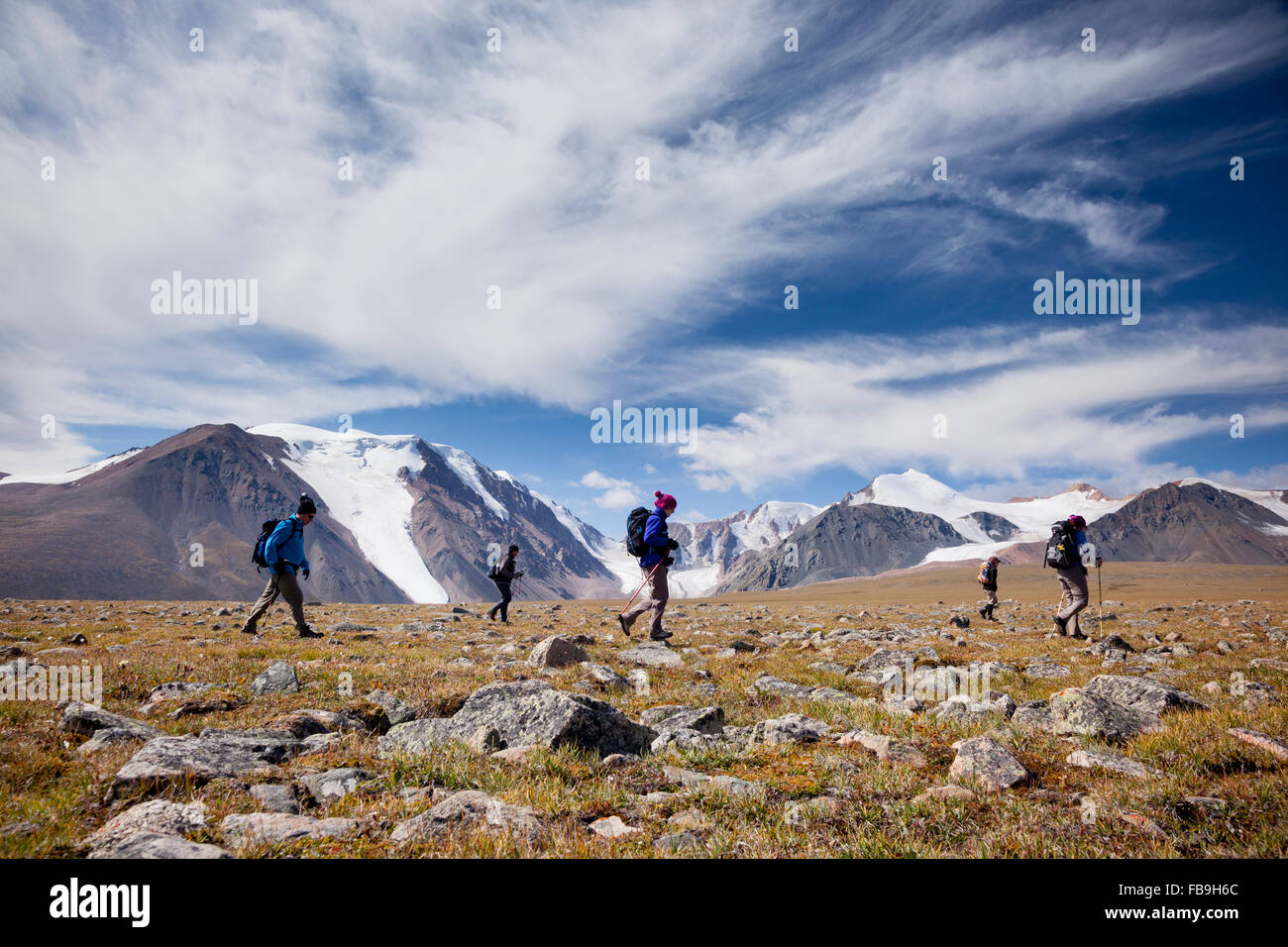 Hiking with Tim Cope on a high pass in the Kharkhiraa and Turgen National Park in the Altai Mountains, Uvs Province, - Stock Image