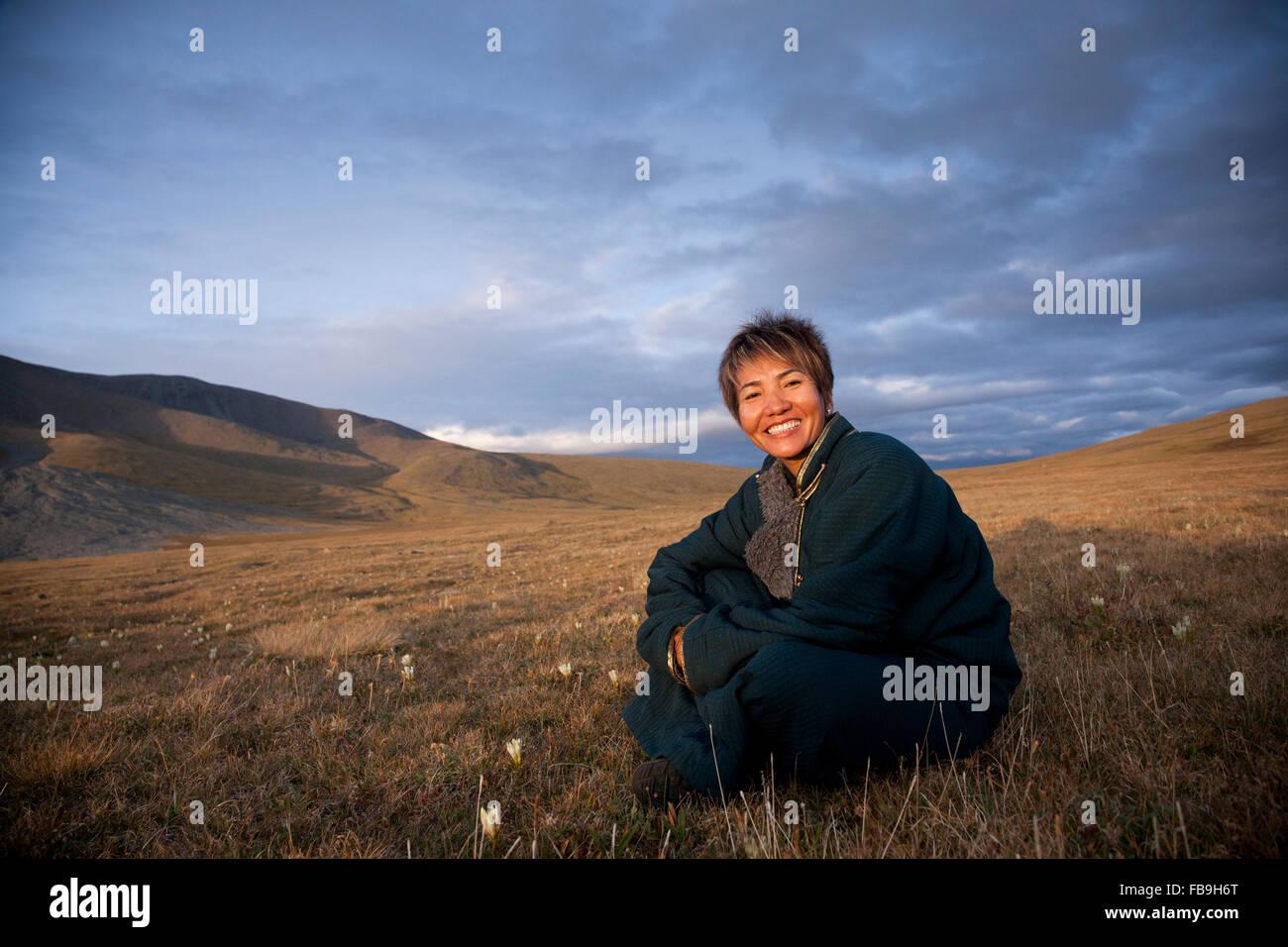Tseren Enebish of Tseren Tours relaxing at sunset in the Kharkhiraa valley in far-western Mongolia. Stock Photo