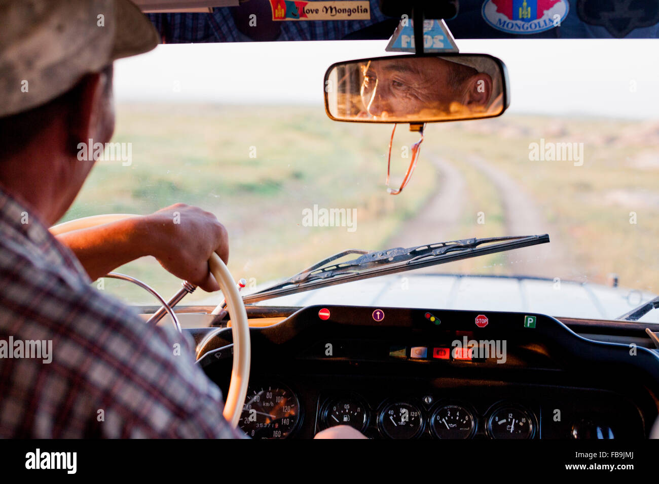A driver with Tseren Tours on the road in a Russian 4WD in the Gobi Desert, Mongolia. - Stock Image