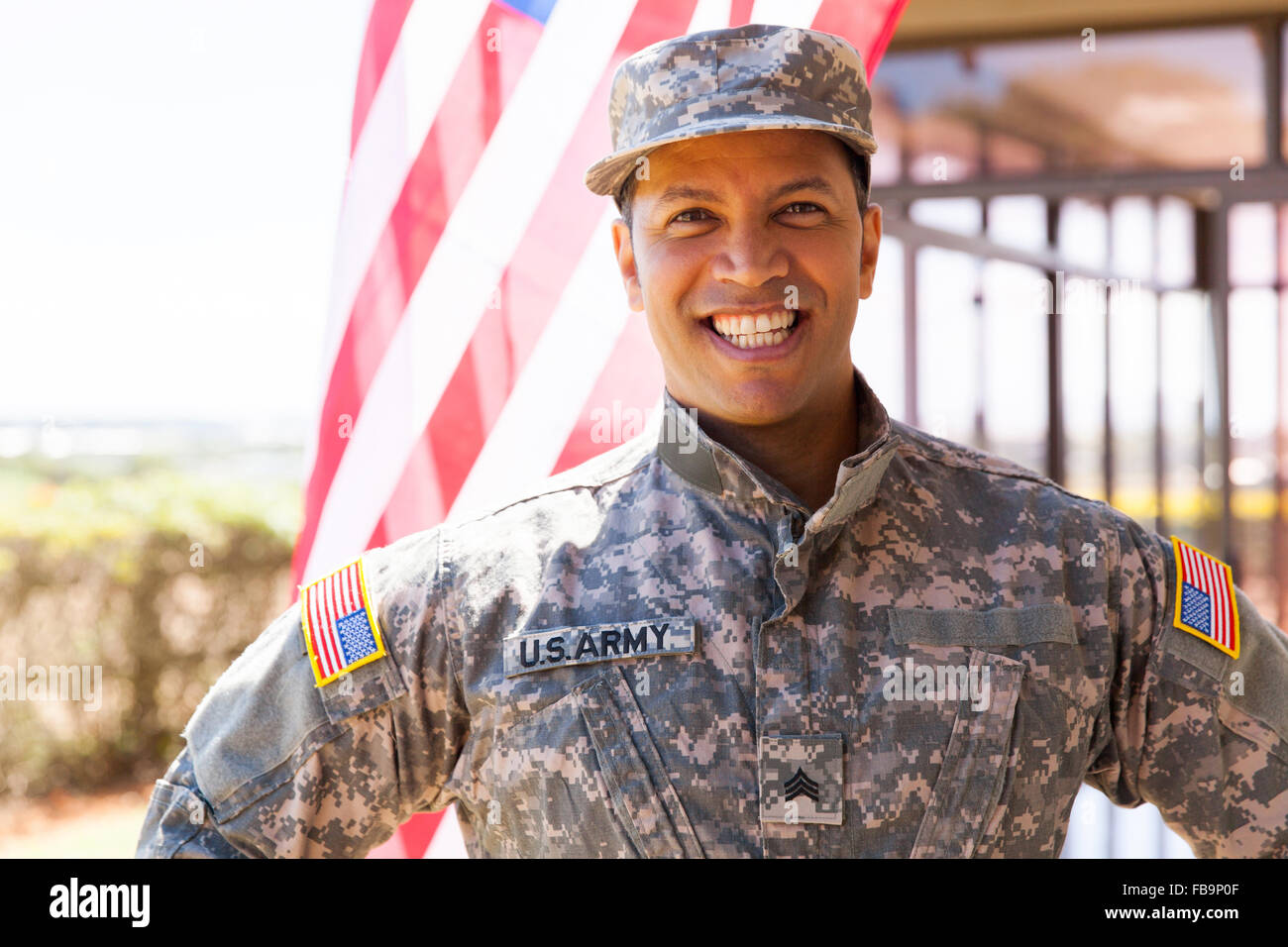 portrait of happy us army soldier outdoors - Stock Image