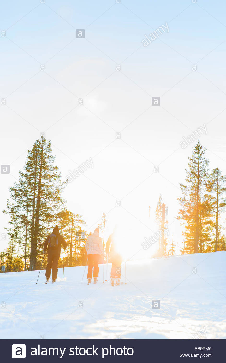 Sweden, Harjedalen, Vemdalen, Klovsjo, Father and two daughters skiing - Stock Image