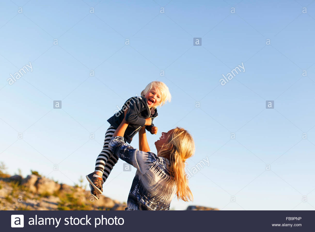 Sweden, Gotland, Faro, Mother playing with little son (2-3) - Stock Image