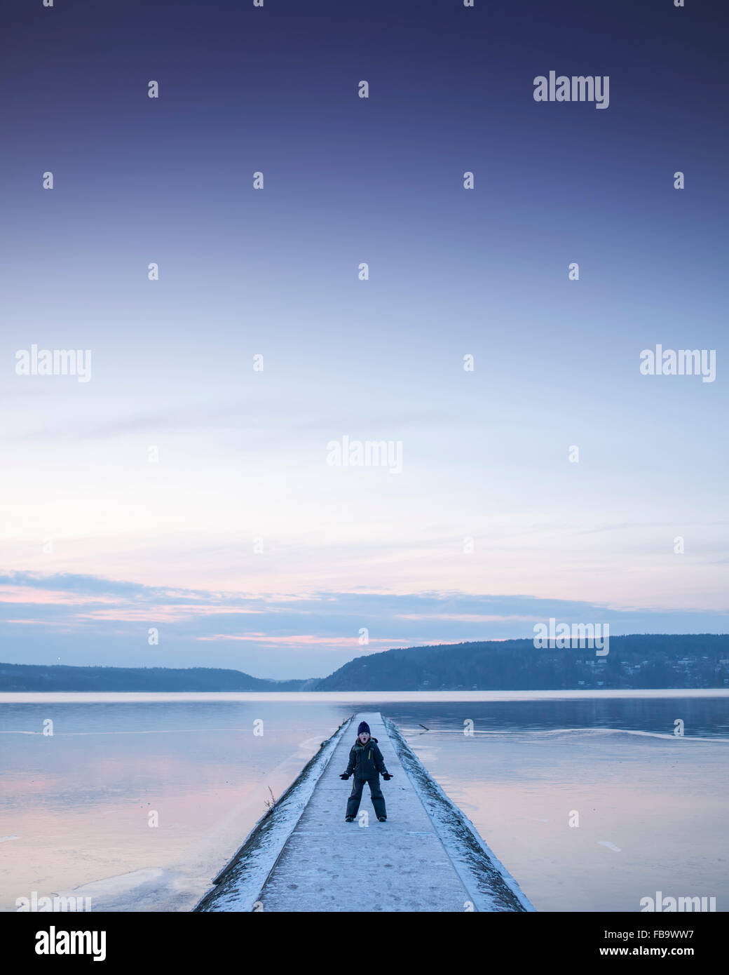 Sweden, Vastergotland, Lerum, Portrait of boy (6-7) on footbridge - Stock Image