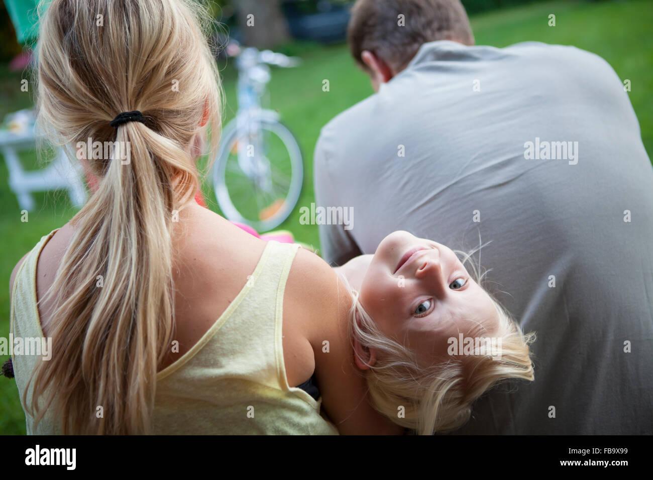 Sweden, Narke, Filipshyttan, Portrait of girls (6-7, 14-15) with father Stock Photo