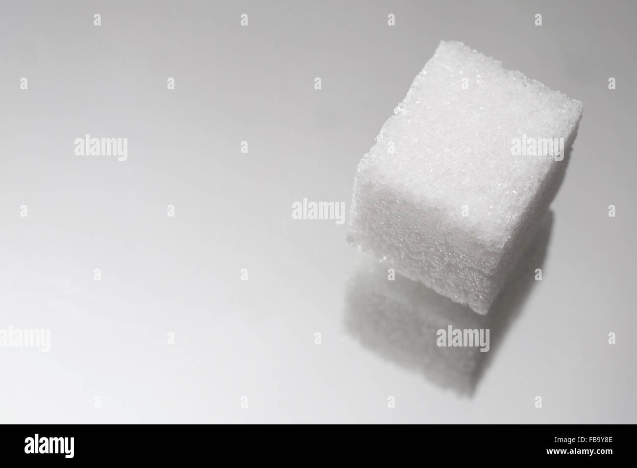 white granulated sugar cubes lumps - Stock Image
