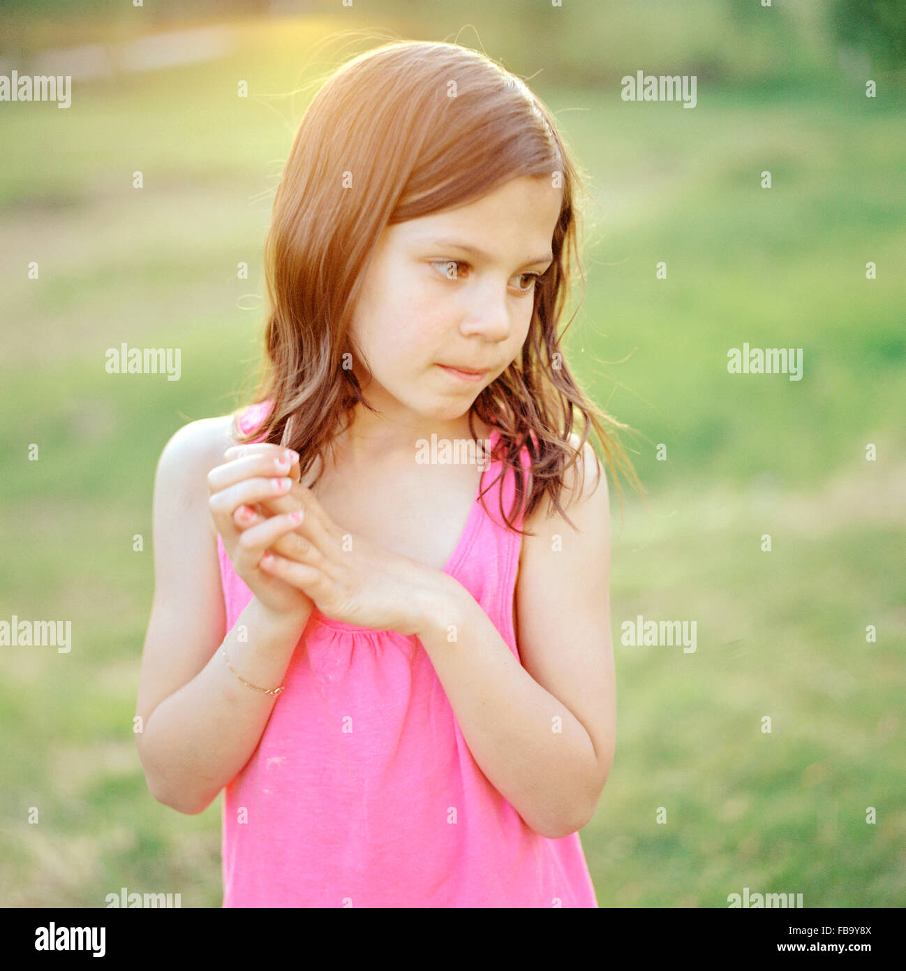 Sweden, Vastmanland, Girl (6-7) wearing pink top - Stock Image