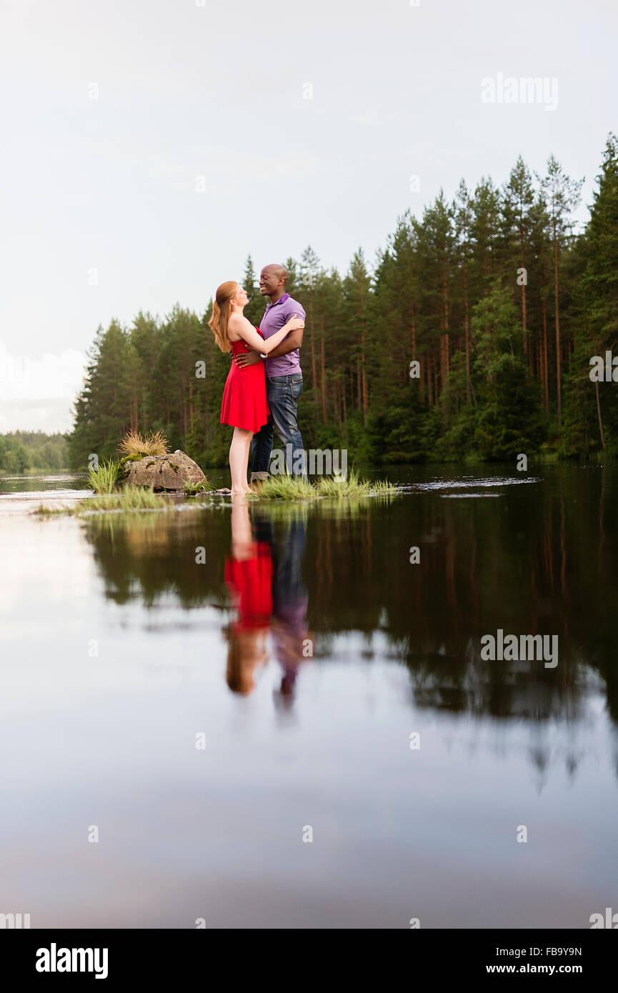 Sweden, Vastmanland, Bergslagen, Svartalven, Mid adult couple embracing - Stock Image