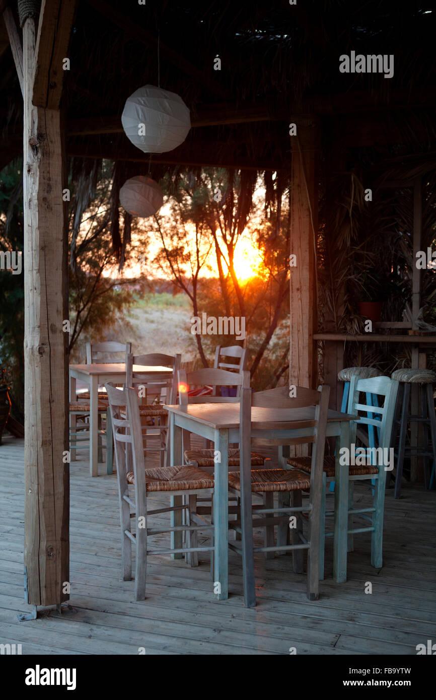 Greek tavern exterior tables near Xi beach Megas Lakkos beach, Lixouri, Kefalonia, Greece - Stock Image