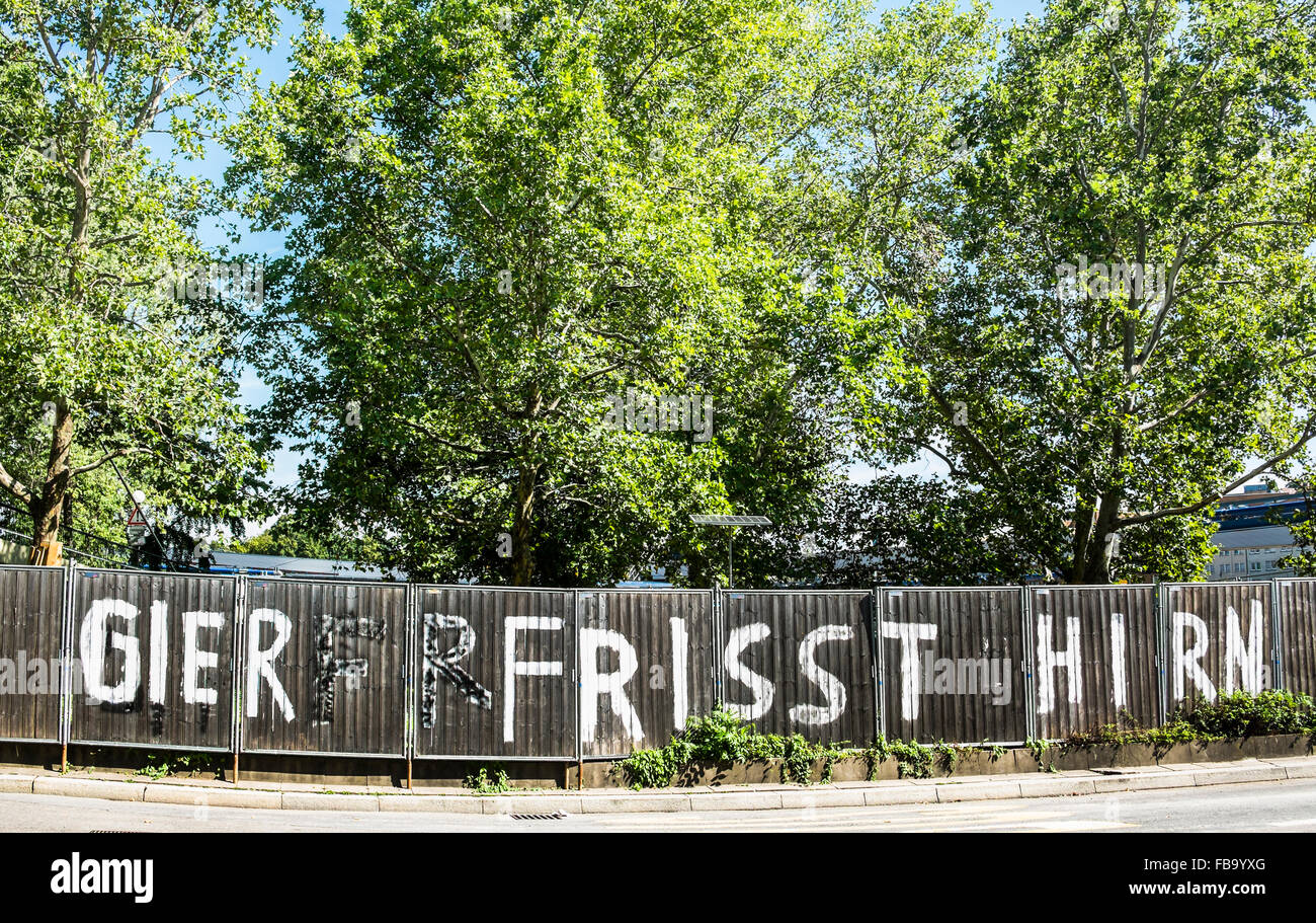 graffito at the site fence of stuttgart 21 railroad project with a text that reads: greed eats brain, stuttgart, - Stock Image