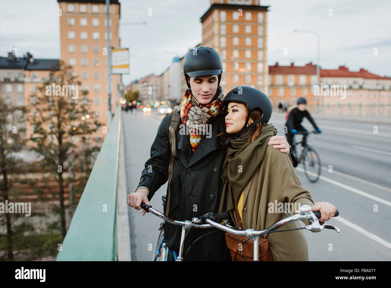Sweden, Uppland, Stockholm, Vasatan, Sankt Eriksgatan, Young couple with bicycles on street Stock Photo