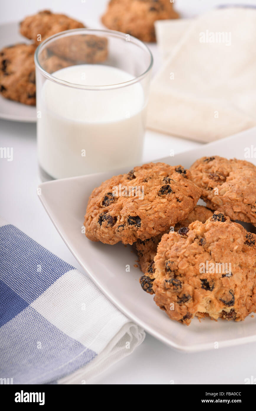 Still life of oatmeal raisin cookies and milk glass - Stock Image