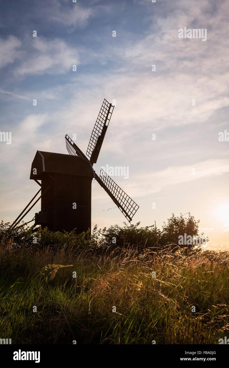 Sweden, Skane, Silhouette of old windmill against sky Stock Photo