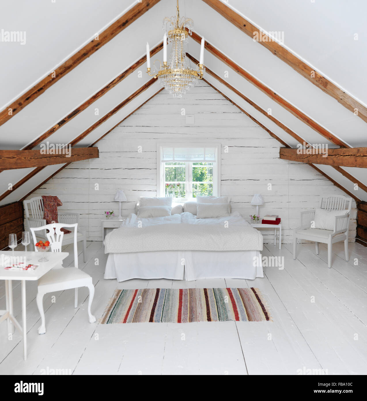Sweden, Attic bedroom in rustic style - Stock Image