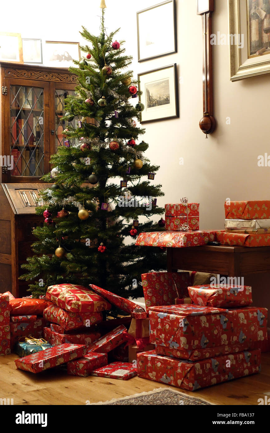 Christmas Tree With Presents Underneath In A Traditional Style Stock