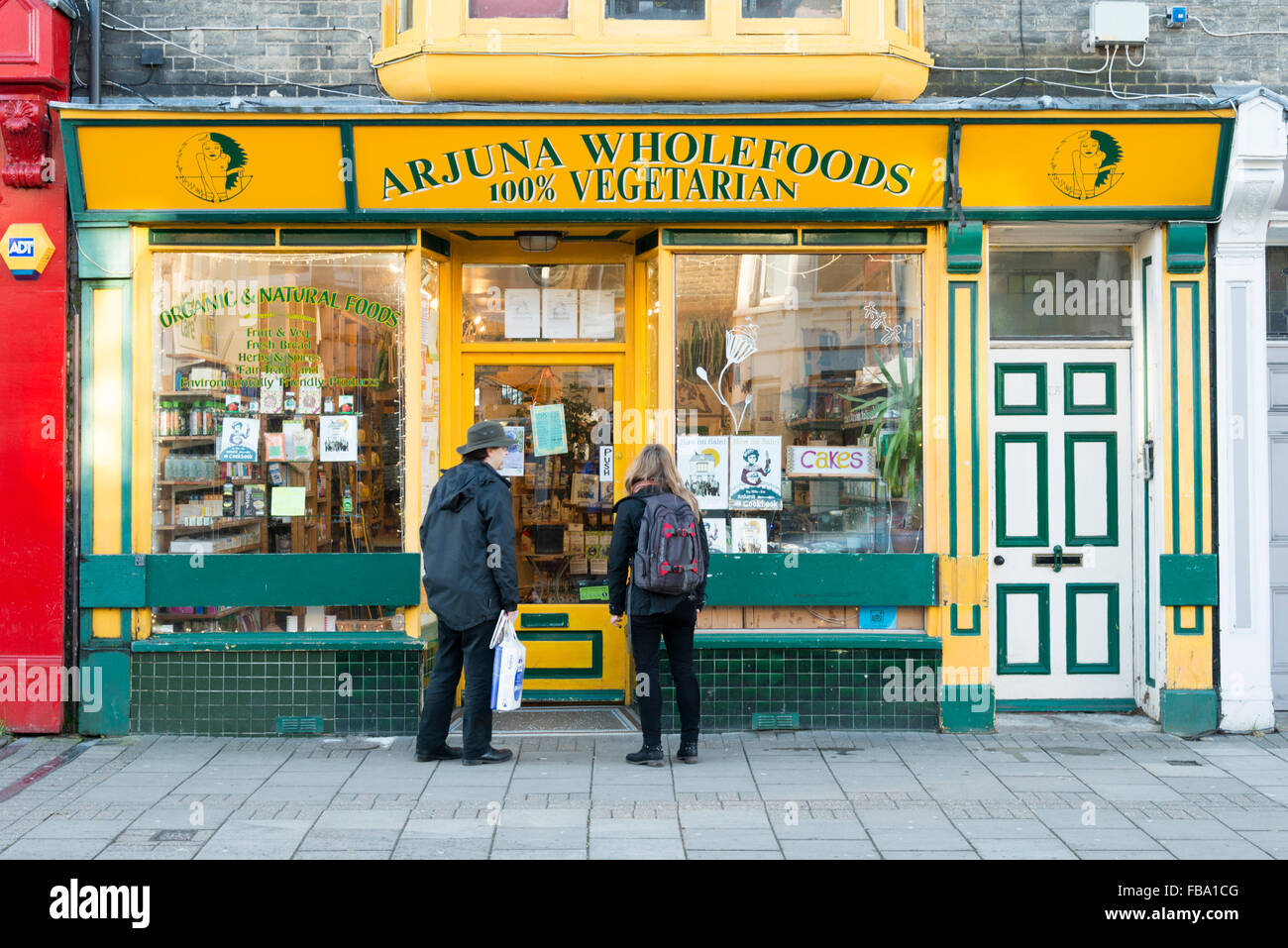 The Arjuna wholefood and vegetarian food independent shop in Mill Road Cambridge UK - Stock Image