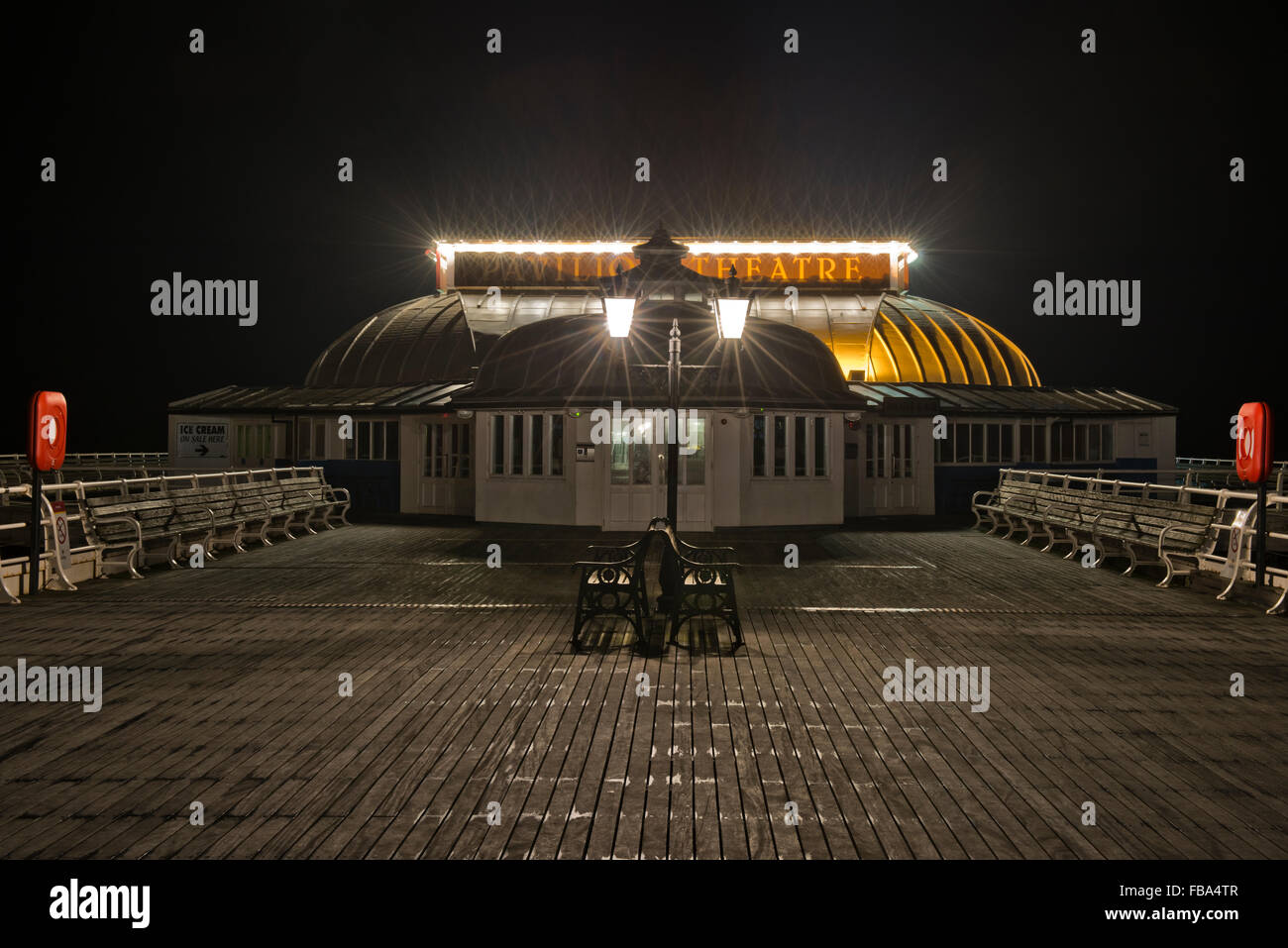Night shot of Cromer Pier, Norfolk, UK - Stock Image