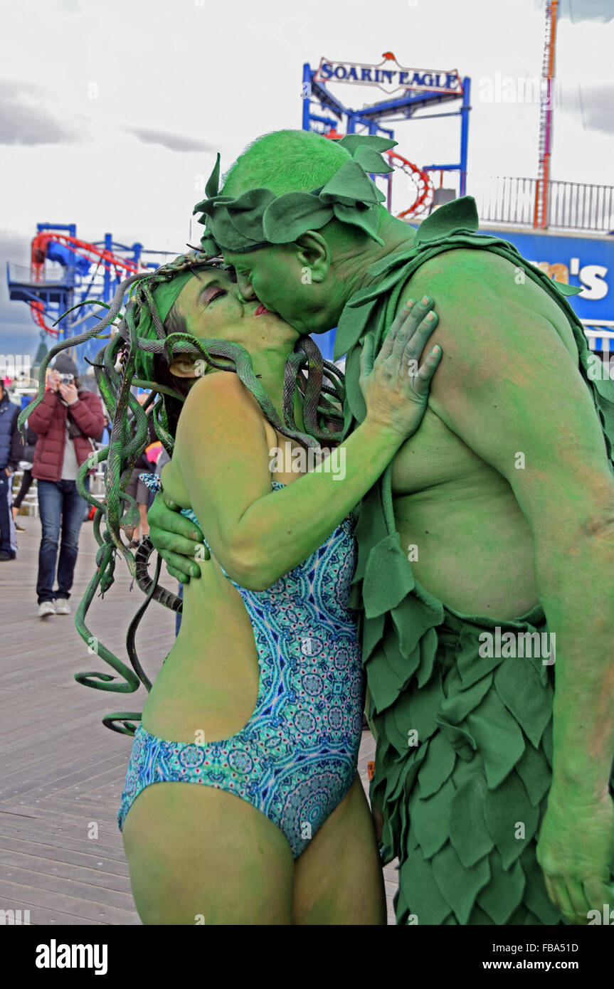 A married couple in elaborate costumes kissing on the boardwalk in Coney Island on New Years prior the the Polar - Stock Image