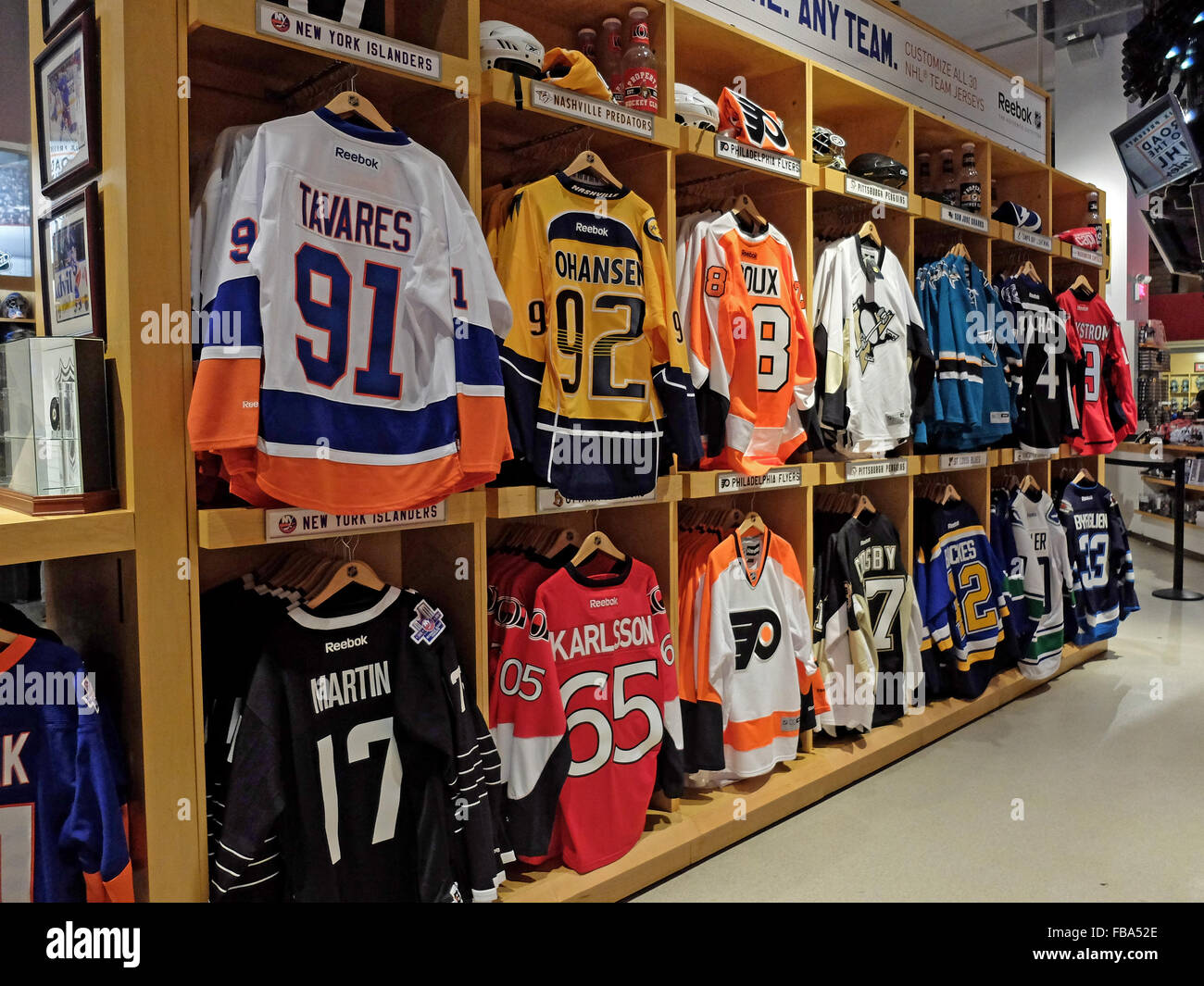 4b53591f7a9 NHL hockey players sweaters for sale at the NHL store on Avenue of the  Americas in Midtown Manhattan, New York City.