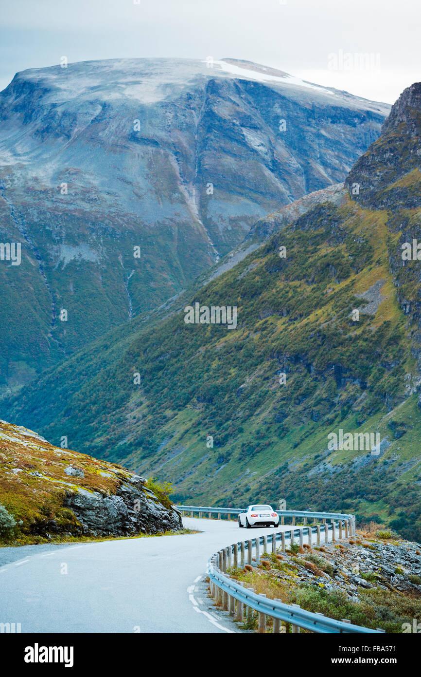 Norway, More og Romsdal, Sunnmore, Geirangerfjord, Car driving away along Trollstigen road, winding in mountain - Stock Image
