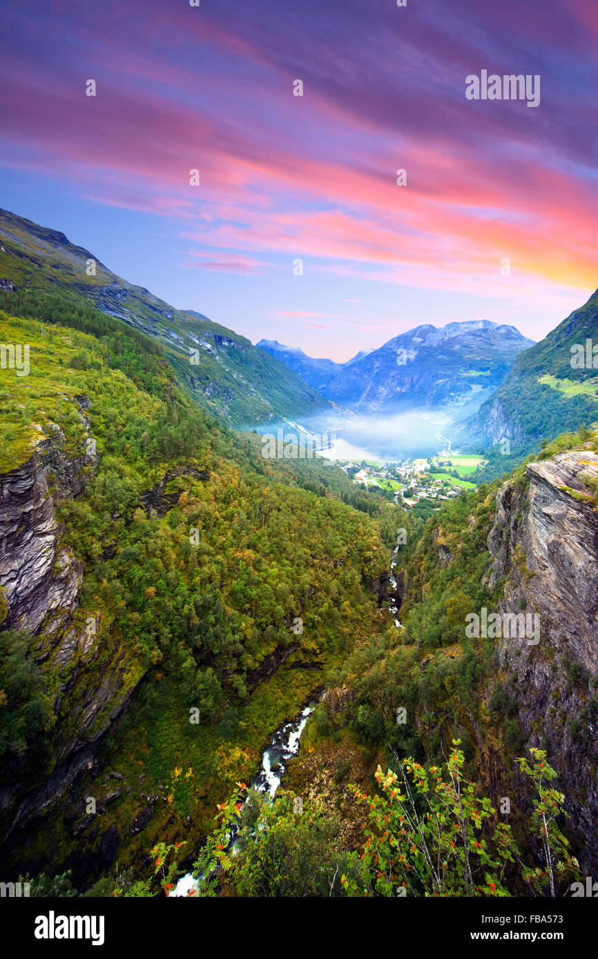Norway, More og Romsdal, Sunnmore, Geiranger, View along wooded canyon with misty lake Stock Photo