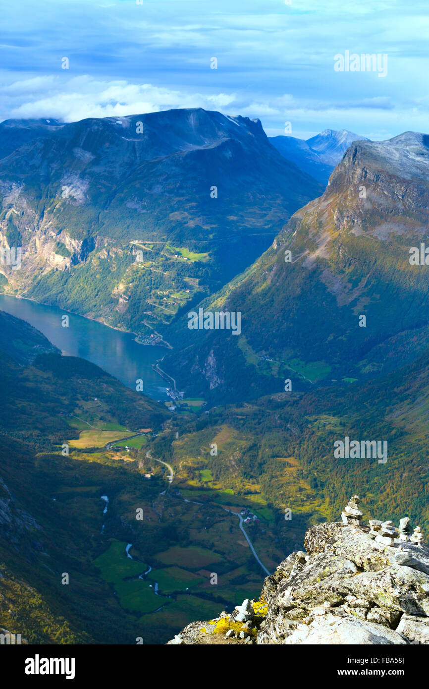 Norway, More og Romsdal, Sunnmore, Geirangerfjord, Elevated view of mountain valley with winding road - Stock Image